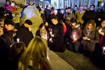Seminarians, students and advisers from the Bernardi Campus, along with others, pray in front of the Obelisk in St. Peter's Square on Feb. 28, 2013. (From left, front row) Savannah Siegler '14, Keith Dewig, Mike Steffes '13 (standing) and Catherine Huss '15. Photo by Mark Brown