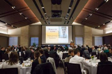 Dr. Michael Naughton gives a speech at the Higher Calling Event in James B. Woulfe Alumni Hall. Photo by Chloé Knutson
