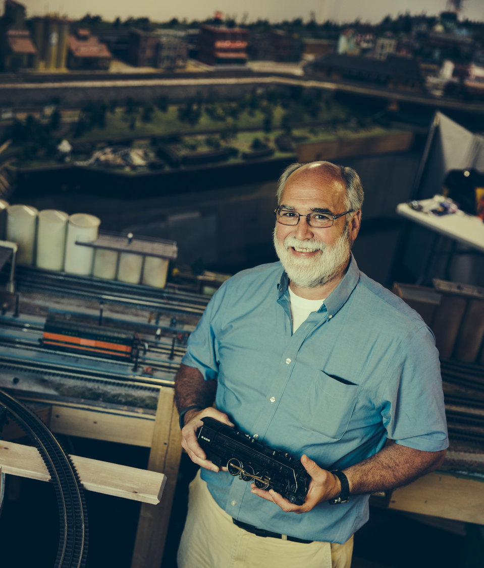 Opus College of Business professor Peter Southard poses with a toy train at the Twin Cities Model Railroad Museum in St. Paul.