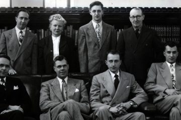 Members of the Biology Department faculty at the College of St. Thomas, 1951. Front row (l-r): John McMillan, William Larson, Frank Ramisch, Paul Germann. Back row (l-r): Carmelo Privera, Mary Keefe, John Asselin, Joseph Reuter. Miss Keefe was the first female appointed as a full-time, tenure eligible faculty member at the College.