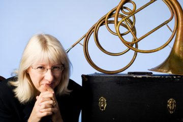 Dr. Sarah Schmalenberger, assistant professor of music history and horn, poses for a photograph with one of her french horns on Thursday, July 16, 2009 for the CAS Spotlight magazine. Schmalenberger is the principal investigator of the Life and Livelihood Study, a national research project she designed to study how breast cancer and its treatment affects women musicians.