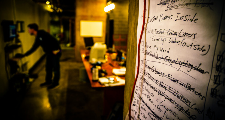 A task list taped to a wall is shown February 11, 2015 at the Minneapolis offices of Minnesota Ice Sculptures. The company was started by student Robbie Harrell (business).