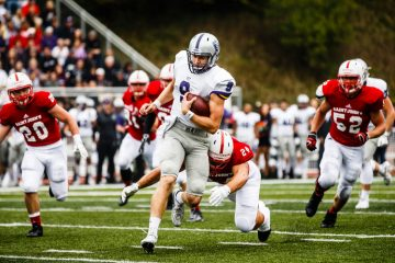 Quarterback Alex Fenske rushes during the 2016 Tommie-Johnnie game in Collegeville.