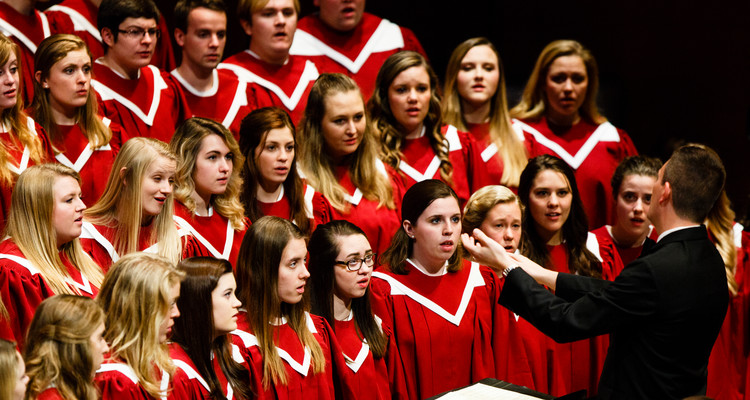 The Liturgical Choir performs during a dress rehearsal for the St. Thomas Christmas Concert December 6, 2015 at Orchestra Hall in Minneapolis.