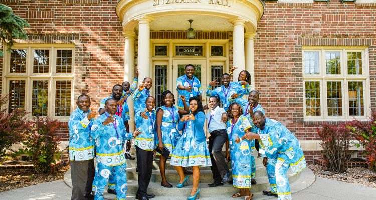Members of the Catholic University Institute of Buea in Cameroon pose for a group photo outside Sitzmann Hall.
