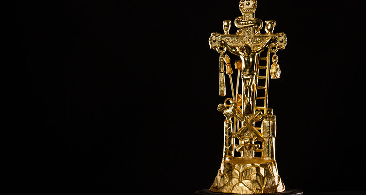 A gold crucifix from the collection of Fr. Dennis Dease is show March13, 2015. Art History tag number 2012.003.006A
