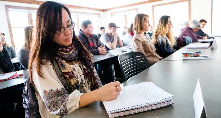Student Alejandra Chavez Rivas listens to a lecture during a Catholic Studies and Business Ethics class December 13, 2016 in Sitzmann Hall.