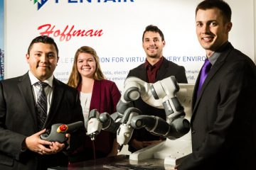 From left, Luis Chavez (Mechanical Engineering), Claire Dunford (Mechanical Engineering), Gabriel Swanton (Electrical Engineering) and Joe Allison (Mechanical Engineering) pose with their Spring Senior Design Team for Pentair on February 9, 2017, in Anoka at the Pentair Anoka location. The Pentair team worked on building a table for a robotic tool and designed software for the robot to use in a manufacturing process.