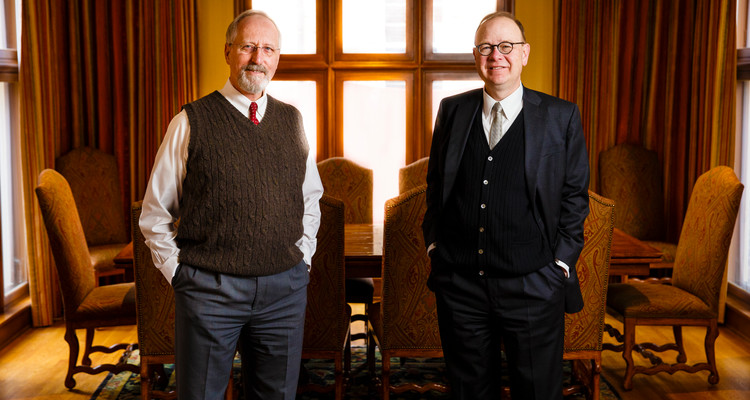 Catholic Studies professor Robert (Bob) Kennedy (left) and John Boyle pose for a portrait in Sitzmann Hall February 24, 2017.