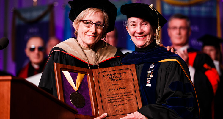 President Dr. Julie Sullivan poses for a photo with outgoing Dean of the School of Social Work Barbara Shank after she was presented with the Distinguished Service Award at the 2017 Graduate Commencement ceremony in the Anderson Athletic and Recreation Complex in St. Paul on May 20, 2017.