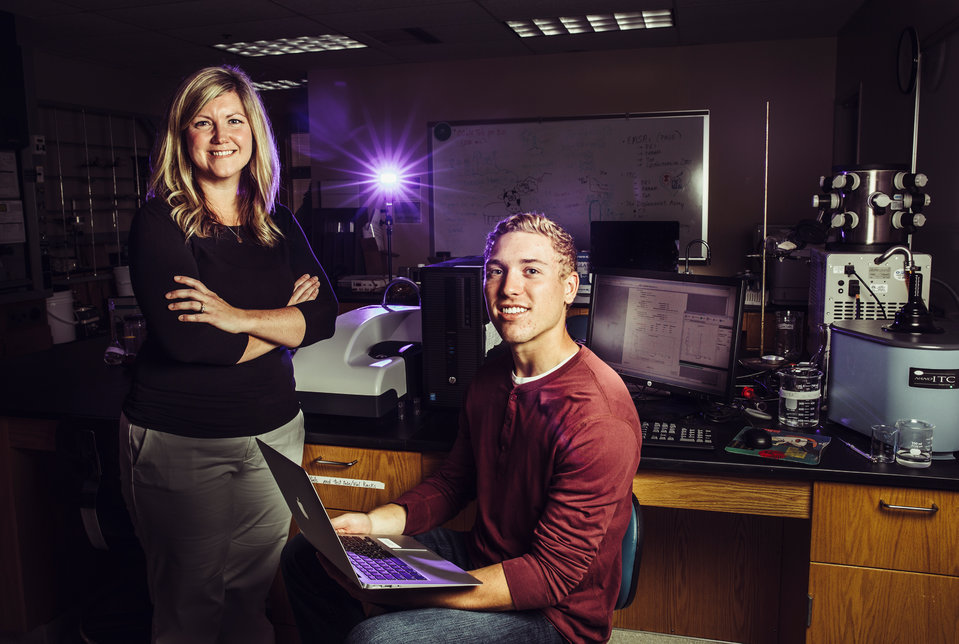 Chemistry professor Lisa Prevette and incoming freshman Jack Queenan pose for a photo in an Owens Science Hall lab on July 27, 2017 in St. Paul. Jack is a recent Minnetonka high school graduate who has been doing chemistry research with Lisa Prevette's lab since last year. This year he is leading his own research project where he's creating nanoparticles that will dissolve when in an acidic environment and will eventually be used to deliver insulin to the bodies of diabetics.