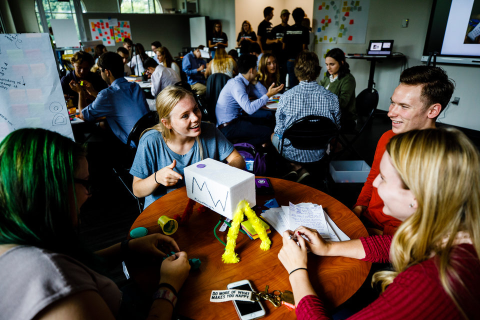 """Students work together on a prototype during an Opus College of Business """"freshman innovation immersion"""" session August 30, 2017 in the Anderson Student Center's creative space (maker space). During the two-day program, incoming students work in groups to solve a given problem with entrepreneurial business techniques."""