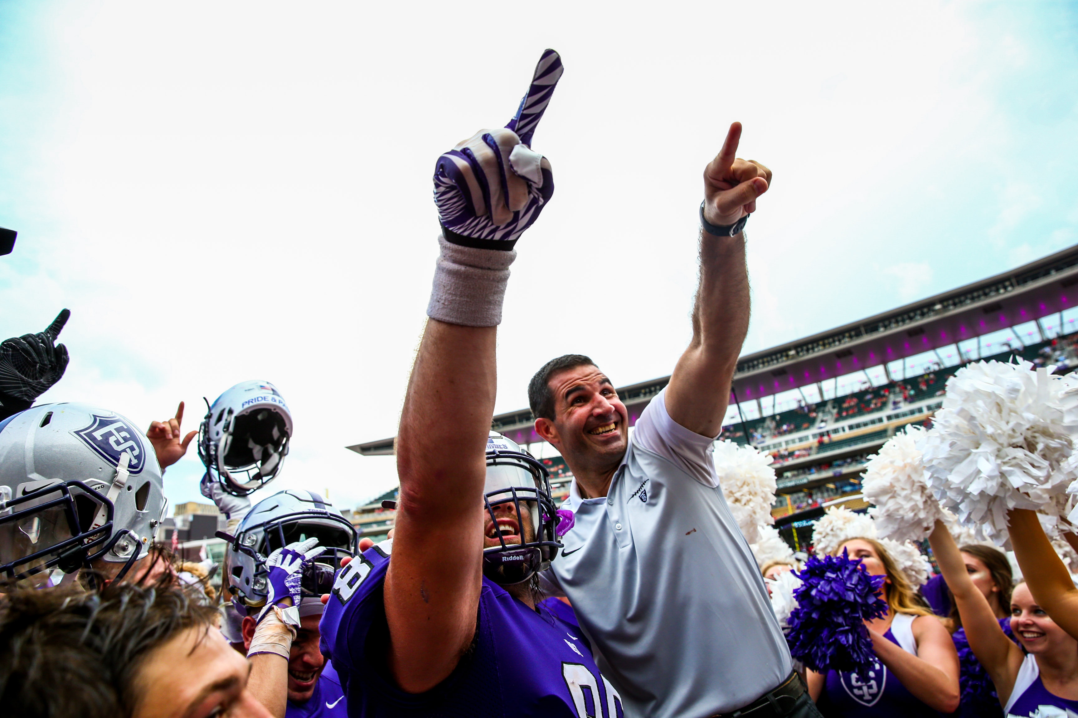 Coach Glenn Caruso and the Tommies celebrate their victory.