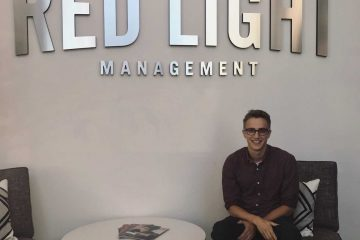 Alex Heimerman poses for a photo at Red Light Management, where he had his Nashville internship this summer.