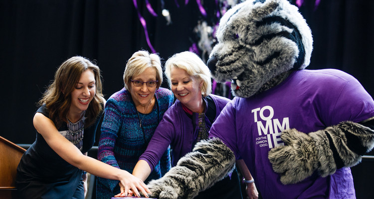 From left: Student Amanda Post, president Julie Sullivan, trustee Amy Goldman and Tommie the mascot push the button that signals the launch of streamers during a launch event for a new Student Achievement and Success initiative November 16, 2017 in the Anderson Student Center. The initiative seeks to raise $200 million for student scholarships and was kicked off by a $50 million donation by the GHR foundation.
