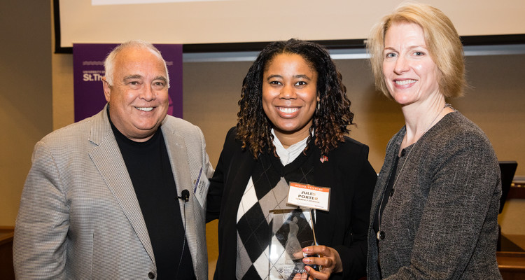 Left to right, Ron Fowler, St. Thomas student Jules Porter and Laura Dunham, chair of the Entrepreneurship Department pose for a photo with an award during the Opus College of Business Schulze School of Entrepreneurship Fowler Business Concept Challenge in the Schulze Hall Auditorium on November 17, 2017 in Minneapolis.