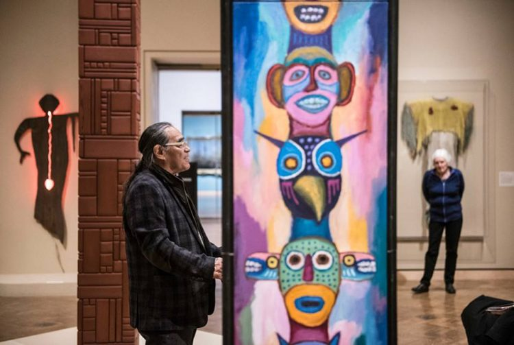 A Minneapolis Institute of Arts visitor examines a Native American art exhibit. (Courtesy of Minneapolis Institute of Arts.)