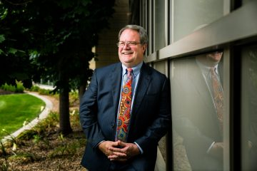 School of Law Professor Jerry Organ poses for a portrait in front of the School of Law Building in Minneapolis on July 19, 2017.