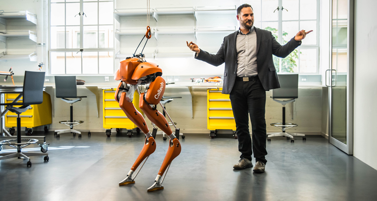 Aaron Ames '01 with robot CASSIE. (Photo provided by Caltech)