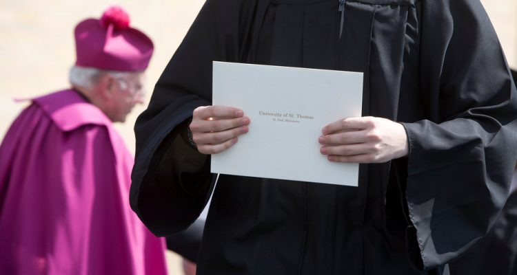 A graduating senior carries her diploma during the University of St. Thomas Undergraduate Commencement in O'Shaughnessy Stadium on Saturday, May 23, 2009.