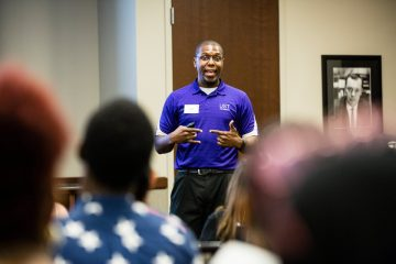 Teron Buford, Assistant Director of Admissions, Coordinator of Multicultural Recruitment, speaks to DFC students in the Anderson Student Center during a Dougherty Family College Info Session tour on July 27, 2017 in St. Paul. Students committed to attending the DFC, along with family and friends, learned about the program and campus facilities.