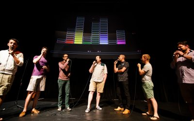 Member of Cantus perform with a projection in the background during a collaborative multimedia performance with the University of St. Thomas Playful Learning Lab and Twin Cities based sining group Cantus at the Science Museum of Minnesota in downtown St. Paul on July 8, 2016.