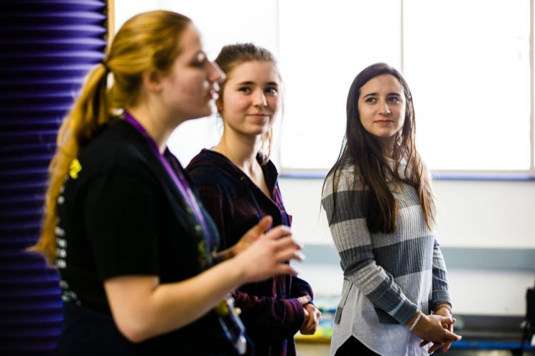 """Students prepare for a presentation during a """"Compleat Engineer"""" class January 19, 2018 in the Facilities and Design Center. The class focuses on teaching communication and teamwork."""