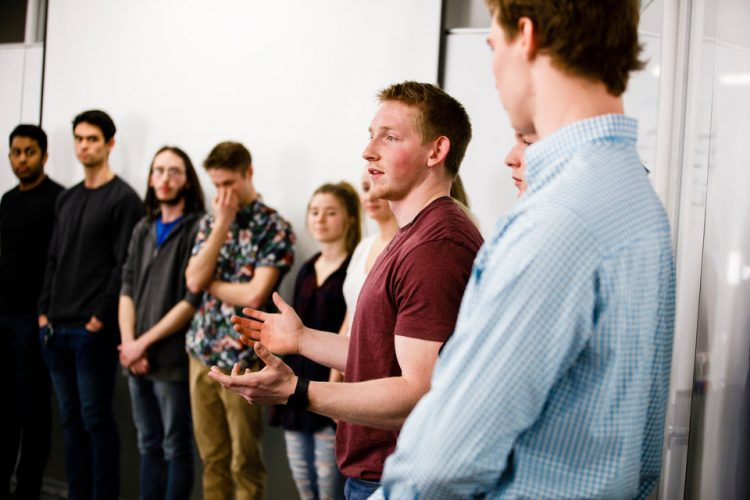 """Students discuss their experience during a """"Compleat Engineer"""" class January 19, 2018 in the Facilities and Design Center. The class focuses on teaching communication and teamwork."""