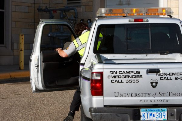 A University of St. Thomas Public Safety officer gets into a public safety vehicle on his way to assist a person who is locked out of their car on Saturday, May 23, 2009.