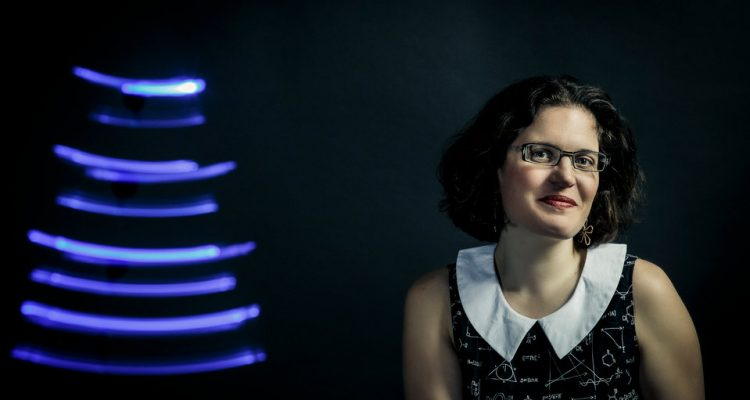 School of Engineering professor AnnMarie Thomas poses for a studio portrait with light-painted tracks made by LEDs March 3, 2015. Taken for the School of Engineering newsletter. Thomas often explores play concepts as a way of teaching engineering.