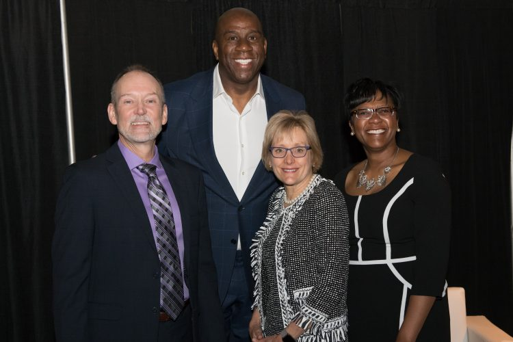 "Steve Humerickhouse Executive Director of The Forum on Workplace Inclusion, Earvin ""Magic"" Johnson, Dr. Julie Sullivan University of St. Thomas President, Dr. Artika R. Tyner Vice President of Diversity and Inclusion and leader of The Forum on Workplace Inclusion pose for a photo. (Copyright 2018 Sarah Morreim Photography)"