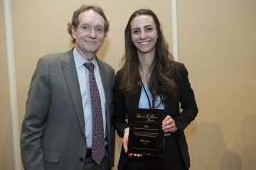 University of St. Thomas law student Mimi Levin receives the Minnesota State Bar Association Bernard P. Becker Award from attorney Larry McDonough.