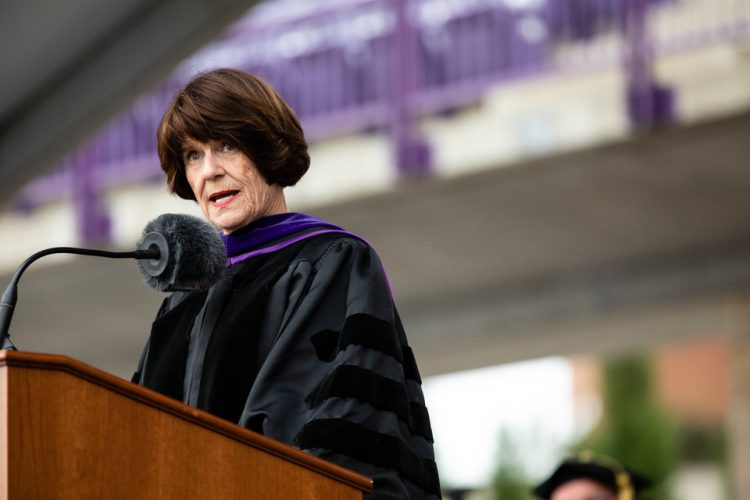 Penny George '95 PsyD, board chair of the George Family Foundation and co-founder of the Penny George Institute for Health and Healing at Allina Health, gives the keynote address during the 2018 Graduate Commencement ceremony in O'Shaughnessy Stadium on May 18, 2018 in St. Paul.