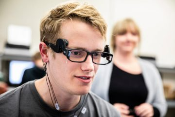 Michael VanDeVoorde wears an EEG sensor, part of his team's senior design challenge working with Medibotics.