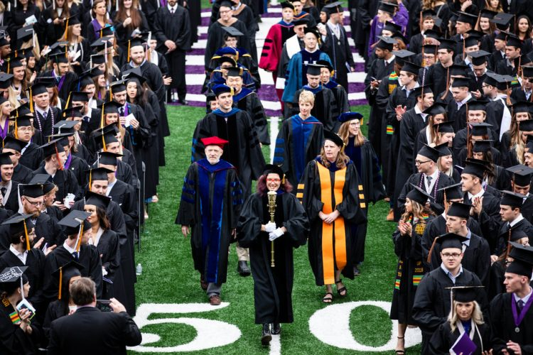 Faculty walks in led by Engineering Professor and Professor of the Year AnnMarie Thomas during the 2018 Undergraduate Commencement ceremony in O'Shaughnessy Stadium on May 18, 2018 in St. Paul.