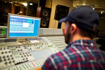 Co-instructor Bo Bodnar works at a mixing board during a music business class at Essential Sessions music studio in St. Paul on March 7, 2013.