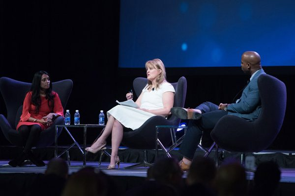 Panelists sit on stage during a presentation at the 2018 Forum on Workplace Inclusion.