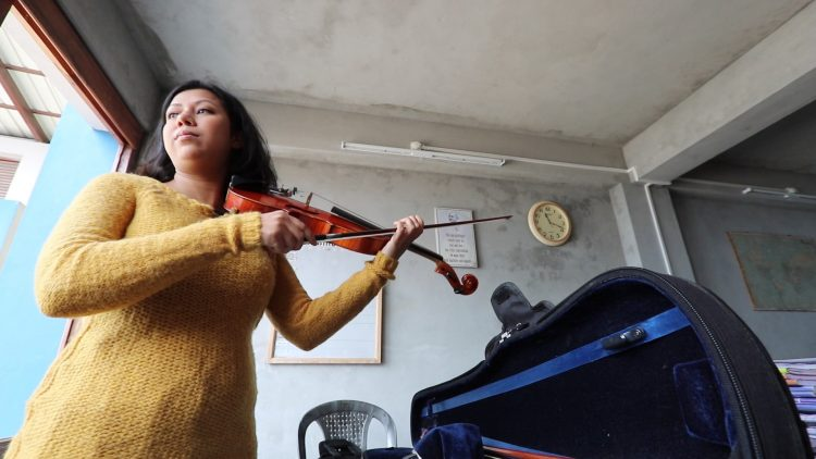 """Fred de Sam Lazaro interviewed Kushmita Bizwakarma 14 years ago as a child violin prodigy and again in 2018 for his """"Under-Told Stories"""" program housed at St. Thomas. (Photo by Deborah Honore '18)"""